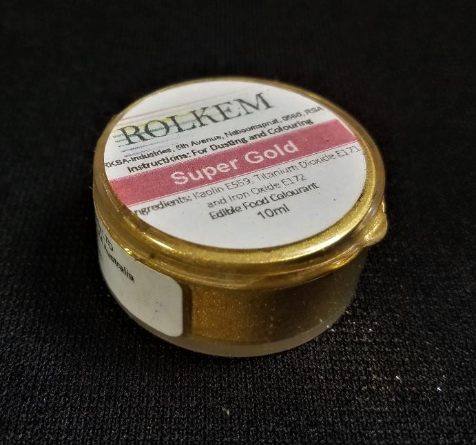 Super Gold Metallic Dust by Rolkem 10ML. This metallic highlighter dust is food approved in Europe, Canada, and Australia, otherwise it is considered non-toxic and for decorative use only. Rolkem super dust colors provide a glossy finish and will give your finished piece a beautiful metallic look. You can paint, mix, or dry brush this dust on fondant, gumpaste, icing, etc. and it leaves a brilliant shine. Color can slightly vary from batch to batch.