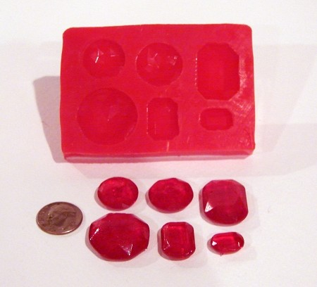 Gem Silicone Mold - 6 different styles. Made of Food Safe Silicone. Great for Chocolate, Isomalt, Fondant or Gumpaste. For size reference, refer to the dime in the picture by Cake Structure.