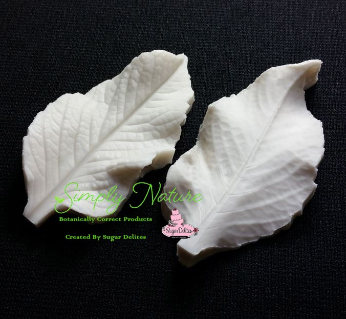 "Dahlia Leaf Veiner by Simply Nature Botanically Correct Products, was created by Jason Dontz and Jennifer Dontz of Sugar Delites, and creates the most realistic Dahlia Leaf interpretation possible. The Dahlia leaf veiner measures 3 1/8"" x 1 5/8"". Simply Nature brand veiners capture each ruffle, pillow & vein because they were created from the actual top and the actual bottom of each leaf or petal, thus creating the most realistic replica of nature.  Botanically correct veiners leave room for your wire and will not cut your paste and since the veiners were created by nature, they also shape and form your medium as well. Each Simply Nature Brand veiner is made in the USA and is poured using the highest quality platinum based, food approved silicone. The matching cutter(s) for this veiner(s) is CUT619."