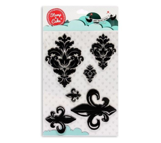 "Damask and Fleur de Lis Stamp Set, by Stamp a Cake, contains 6 different damask and fleur de lis design stamps. The largest stamp measures 4 3/8"" x 3 1/8"" and the smallest stamp measures 1 1/4"" x 1 1/8"". Stamp a Cake allows you to transfer gorgeous designs to fondant cakes, cookies, and cupcakes using food grade silicone and edible ink. Each Stamp a Cake design stamp is designed to be used specifically for confectionery use and only with Stamp a Cake edible ink. Black, gold, silver and white are the current available colors that can be used. The white Stamp a Cake color is used as a base color and it can be colored the shade of your choice by mixing in small amounts of coloring gel to achieve the desired color."