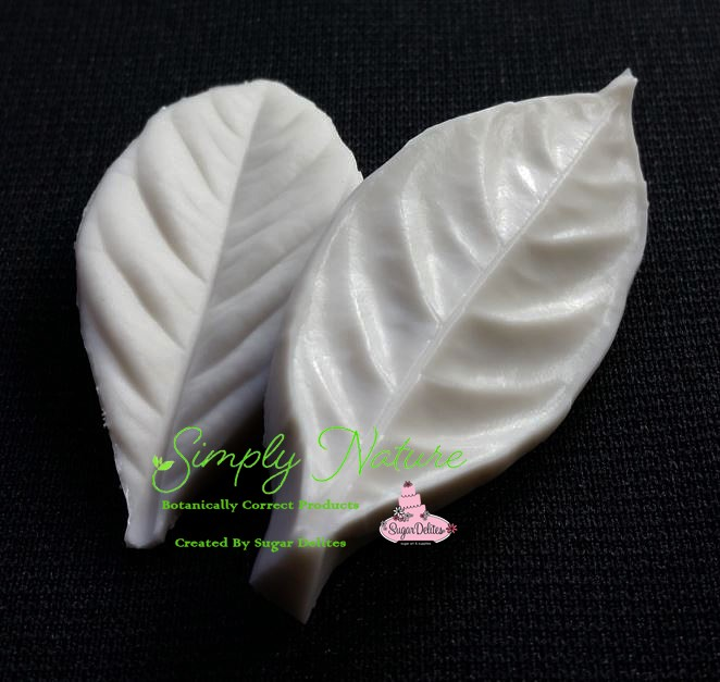 "Gardenia Leaf Veiner Small by Simply Nature Botanically Correct Products, was created by Jason Dontz and Jennifer Dontz of Sugar Delites, and creates the most realistic Gardenia leaf interpretation possible. The Gardenia leaf veiner small measures 2 3/8"" x 1"". Simply Nature brand veiners capture each ruffle, pillow & vein because they were created from the actual top and the actual bottom of each leaf or petal, thus creating the most realistic replica of nature.  Botanically correct veiners leave room for your wire and will not cut your paste and since the veiners were created by nature, they also shape and form your medium as well. Each Simply Nature Brand veiner is made in the USA and is poured using the highest quality platinum based, food approved silicone. The matching cutter(s) for this veiner(s) is CUT604."