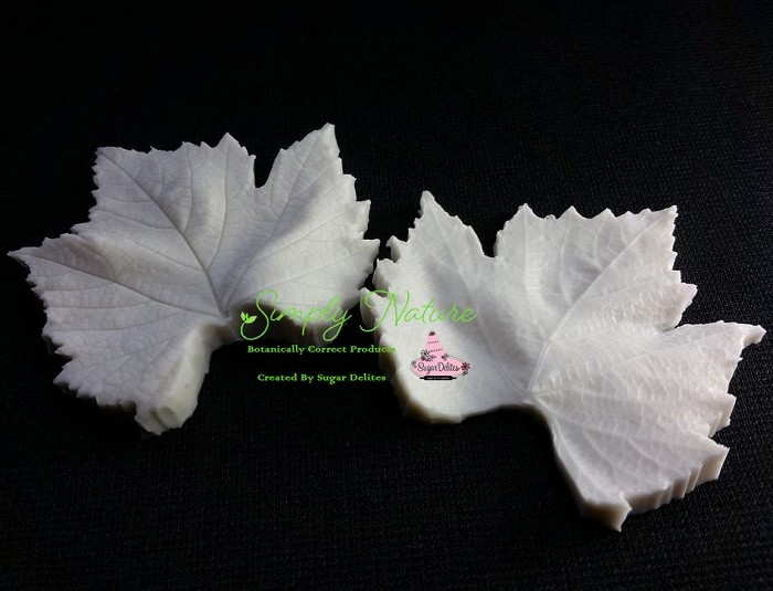 "Grape Leaf Veiner Medium by Simply Nature Botanically Correct Products, was created by Jason Dontz and Jennifer Dontz of Sugar Delites, and creates the most realistic Grape leaf interpretation possible. The Grape leaf veiner medium measures 2 3/4"" x 2 1/2"". Simply Nature brand veiners capture each ruffle, pillow & vein because they were created from the actual top and the actual bottom of each leaf or petal, thus creating the most realistic replica of nature.  Botanically correct veiners leave room for your wire and will not cut your paste and since the veiners were created by nature, they also shape and form your medium as well. Each Simply Nature Brand veiner is made in the USA and is poured using the highest quality platinum based, food approved silicone. The matching cutter(s) for this veiner(s) is CUT610."