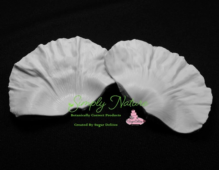 "Poppy Petal Veiner XL by Simply Nature Botanically Correct Products, was created by Jason Dontz and Jennifer Dontz of Sugar Delites, and creates the most realistic Poppy petal interpretation possible. The Poppy Petal Veiner XL measures 4 1/2"" x 3 3/8"". Simply Nature brand veiners capture each ruffle, pillow & vein because they were created from the actual top and the actual bottom of each leaf or petal, thus creating the most realistic replica of nature.  Botanically correct veiners leave room for your wire and will not cut your paste and since the veiners were created by nature, they also shape and form your medium as well. Each Simply Nature Brand veiner is made in the USA and is poured using the highest quality platinum based, food approved silicone. The matching cutter(s) for this veiner(s) is CUT590."