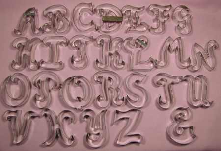 "Alphabet Upper Case Fancy 3"", by Edith De La Flor, includes 26 Alphabet cutters. The ""M"" and ""W"" are interchangeable and the set also includes the ""&"" character. Each letter measures approximately 3"" tall. Due to the size of the cutters, additional shipping may be necessary."