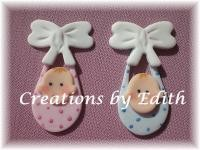 "Baby Bundle Cupcake Cutter by Edith De La Flor. The completed Large Baby Bundle measures 1 1/4"" x 3"" and the completed small Baby Bundle measures 1"" x 1 7/8""."