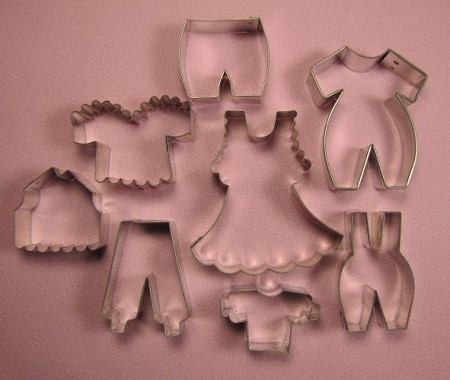 "Baby Clothes #2, by Edith De La Flor, includes 8 total cutters. The largest Baby Clothes cutter measures 2 5/8"" x 2 1/2"" and the smallest Baby Clothes cutter measures 1"" x 1 3/4""."