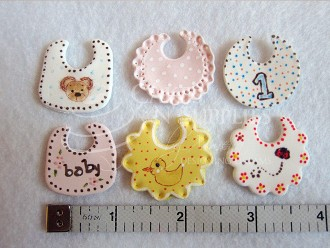 "Baby Bib Set of 3 ad finished photo and product by:  Cakes by Ximena includes 3 different sized Bib cutters. Each Bib cutter measures approximately 1 1/4"" x 1 1/4""."