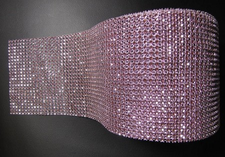 "Rhinestone Baby Pink Bling is sold in 3 ft. (1 yard) long x 4 1/2"" tall lengths. This Bling is very shiny and is sure to make any cake ""pop."" The Bling can easily be cut with scissors and has a silver backing. Non-edible or FDA approved. If using this product on an edible item, a barrier between the bling and edible item is recommended."