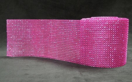 "Rhinestone Hot Pink Bling is sold in 3 ft. (1 yard) long x 4 1/2"" tall lengths. This Bling is very shiny and is sure to make any cake ""pop."" The Bling can easily be cut with scissors and has a silver backing. Non-edible or FDA approved. If using this product on an edible item, a barrier between the bling and edible item is recommended."