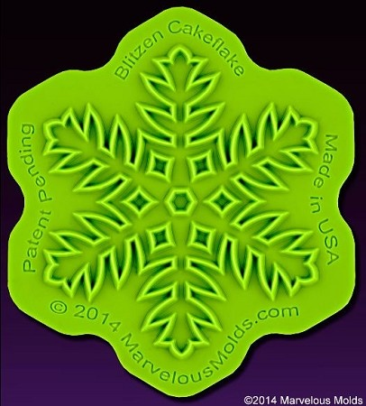 "Snowflake Blitzen Cakeflake Onlay, by Chef Dominic Palazzolo of Marvelous Molds, measures 2 1/2"" x 2 1/2"". This FDA approved silicone Onlay will transfer its precise raised design onto most surfaces, perfectly every time. Onlays are great for sugar art related mediums, such as fondant, modeling chocolate and gumpaste."