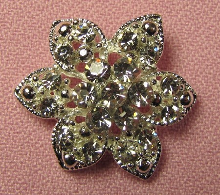 "Brooch BLING Flower Button measures 1"" x 1"" x 3/8"". This rhinestone covered button is great for fantasy flowers or for adding BLING to any cake. As shown in Beautiful Sugar Shoes, by Sugar Artist Iris Rezoagli."
