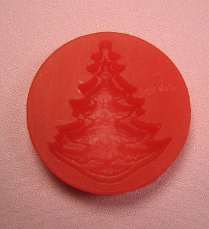 "Christmas Tree, by CakeStructure, measures 2 1/4"" x 1 7/8"" x 3/8""."