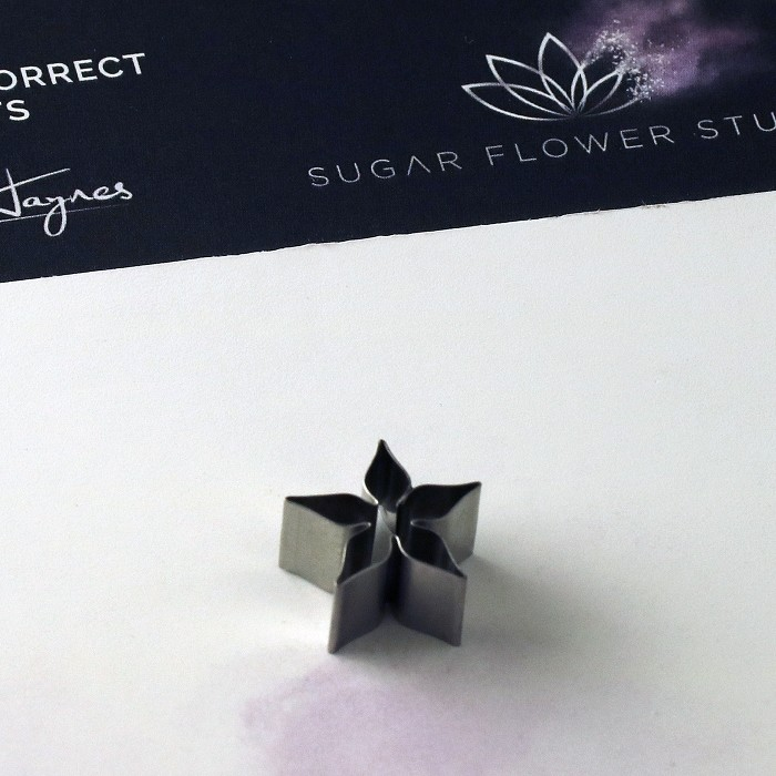 "Blackberry Calyx stainless steel small cutter measurements – length 1.4 cm x width 1.4 cm. (length 5/8"" x width 5/8"").This distinctive range of Botanically Correct Products By Sugar Flower Studio are designed by master sugar artist Robert Haynes. These quality products can be used to replicate time and again, stunning life like flora in any edible or non-edible medium of your choice. The stainless-steel cutters in the Sugar Flower Studio range are perfectly matched to fit within the perimeters of each corresponding silicone veiner, giving you a time efficient and botanically correct result each time. These cutters can be used with edible mediums including sugar flower paste (SFP) gum paste, fondant, modelling chocolate and marzipan. They can also be used with non-edible modelling mediums: cold porcelain (Modena), Hearty - Artista soft, polymer clay and modelling clay. Instructions for use of products: Using the Sugar Flower Studio Hand saver, place on top of each cutter, cut out petals or leaves. Place thinned out petal or leaf shape into lightly corn-floured Sugar Flower Studio veiner. Press firmly to give a natural vein. Remove petal or leaf and allow medium to go leathery before colouring. To clean cutters, wipe with an alcohol dampened soft cloth after each use. Copyright © 2016 Sugar Flower Studio."