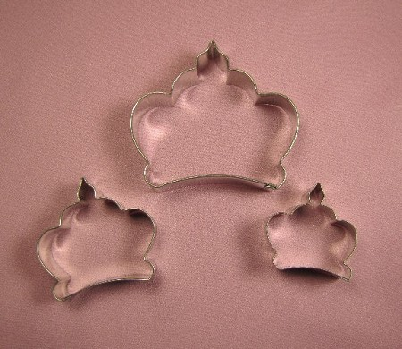 "Crown Set of 3, by Fiesta, includes 3 different sized Crown cutters. The largest Crown measures 3 1/4"" x 3"", the medium Crown measures 2 1/4"" x 2"", and the smallest Crown measures 1 5/8"" x 1 5/8""."