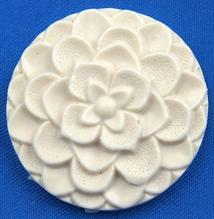 "Dahlia Button measures 1 1/8"" by 1 1/8""."