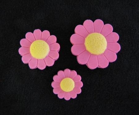 "Daisy Trio, by Jennifer Dontz, is a 3 cavity mold. The largest Daisy measures 1"" x 1"" x 1/8"", the medium sized Daisy measures 3/4"" x 3/4"" x 1/8"", and the smallest Daisy measures 1/2"" x 1/2"" x 1/8"". The finished Daisy's are made of colored gumpaste."