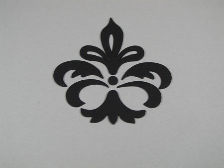 "These beautiful damask cutters will surely please your customers wanting the popular Damask look on their cake. The cutters that have a uniform shape, have the rolled edge to them. The other cutters, that you will want to do a mirror image, don't have the rolled edge so you can get the reverse pattern will be clean. The dots in the picture were cut out using Wilton tip 12. You can also easily pipe any dots into the design. Suggested design measures 3 1/2"" x 3 1/2"", 6 piece set, by Jennifer Dontz."