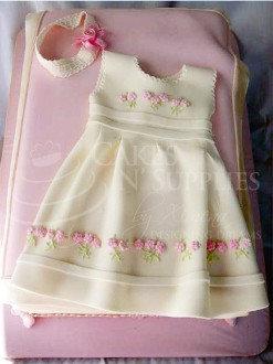 "This very cute Baby Dress has 4 pieces to it. Finished photo and product by:  Cakes By Ximena.  It fits nicely on a 9"" x 13"" cake. The skirt cutter measures 6 1/2"" x 11"". Instructions included."