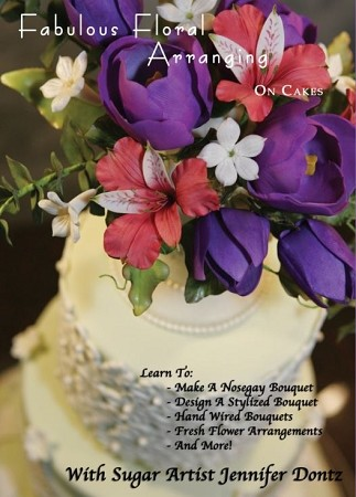 Sugar artist and former florist, Jennifer Dontz, will guide you through the process of how to create beautiful floral arrangements on your cakes.  Using both sugar (gumpaste) flowers and fresh, you will gain the skills needed to kick your cakes up to to the next level.  Jennifer will also show step by step how to make a beautiful sugar vase to arrange your flowers in.  Learn several arranging styles in this easy to follow DVD. DVD Runtime: 90 Minutes. Note: This is an NTSC Region Free DVD.