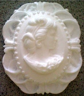 "Fancy Single Cameo measures approximately 2"" x 1 1/2""."