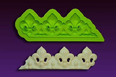 "Fleur De Lis Border Mold, by Chef Dominic Palazzolo, measures 7"" x 2 1/4"". The mold features Chef Palazzolo's patented trimming ""Blade."""