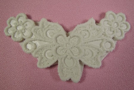 "Floral Lace Applique Blossom V DTC is a double sided lace press and measures 3 3/4"" x 2""."
