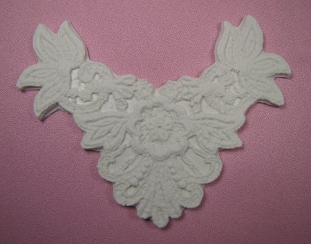 "Floral Medallion Medium is a double sided lace press and measures 5 1/2"" x 4""."