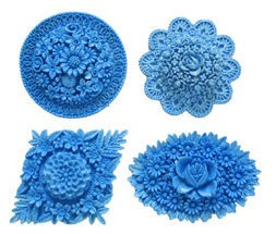 "Assorted Flower Medallions. Each Medallion measures approximately 1 3/4"" x 2 1/2"" x 1/2""."