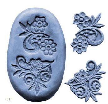 "Flower Designs Press, set of 2. Each flower press measures approximately 2"" x 1 1/2""."