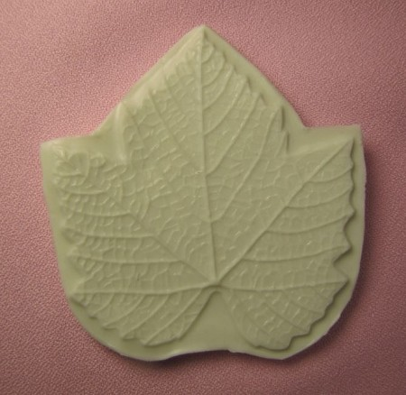 "Grape Leaf Veiner measures approximately 3"" x 3""."