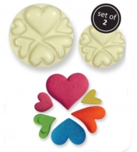 "Heart Set By JEM is a plastic ""Pop It"" mold that creates several different heart shaped designs. The smallest heart design measures 1/4"" x 1/4"" and the largest heart measures 1 3/8"" x 1 1/4"". These pop it molds are easy to use and complete instructions are included."