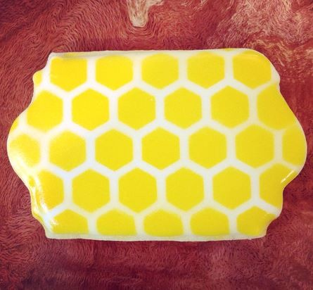 "Honeycomb Stencil, by The Cookie Countess, creates a Honeycomb design pattern that measures 5"" x 4 3/4"". This Honeycomb stencil is great for cookies, cupcakes, cakes, and more. Finished cookie by Hillary Ramos."