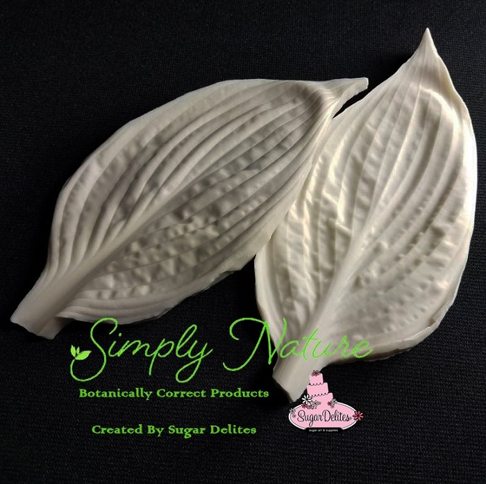 "Hosta Leaf Veiner XL by Simply Nature Botanically Correct Products, was created by Jason Dontz and Jennifer Dontz of Sugar Delites, and creates the most realistic Hosta Leaf interpretation possible. The Hosta leaf veiner XL measures 6 1/2"" x 3"". Simply Nature brand veiners capture each ruffle, pillow & vein because they were created from the actual top and the actual bottom of each leaf or petal, thus creating the most realistic replica of nature. Botanically correct veiners leave room for your wire and will not cut your paste and since the veiners were created by nature, they also shape and form your medium as well. Each Simply Nature Brand veiner is made in the USA and is poured using the highest quality platinum based, food approved silicone. The matching cutter(s) for this veiner(s) is CUT686."