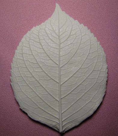 "Hydrangea Leaf Veiner, by Jennifer Dontz, measures 4 3/4"" x 3 1/2"". This Hydrangea Leaf Veiner is made from a real Hydrangea Leaf. The details on this mold are fantastic. Single sided."