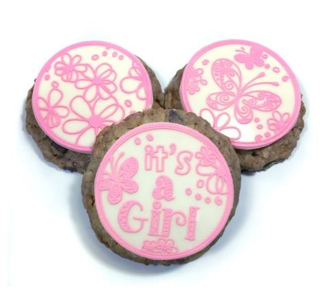 "It's a Girl Chocolate Disc Mat by Crystal Candy creates 4 different chocolate disc designs. Each design measures approximately 2 1/8"" x 2 1/8"". These discs are made using a 2 step process. The first coat consists of either chocolate or cake lace and the second coat consists of chocolate. These are very easy to make and a full tutorial is available under the ""Tutorials"" tab at the top of this page. Click on the February 2016 link."