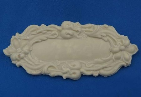 "Brooch Long Oval Flat Center measures 3 5/8"" x 1 5/8"". All DTC Molds, veiners and lace presses are made from flexible food-grade silicone."
