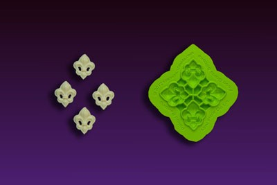 "Mini Fleur De Lis Mold, by Chef Dominic Palazzolo, includes 4 miniature Fleur De Lis. Each Fleur De Lis measures 7/8"" x 1"". The mold features Chef Palazzolo's patented trimming ""Blade."""