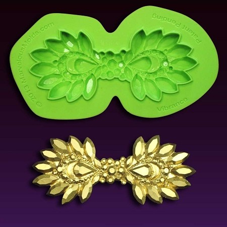 "Brooch Vibrance Mold, by Marvelous Molds, measures 4"" x 1 3/4""."