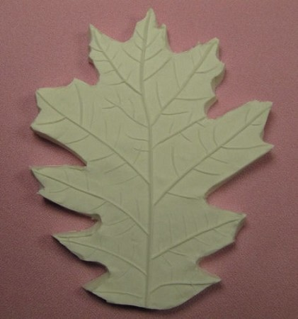 "Oak Leaf Veiner, by Jennifer Dontz, measures 5"" x 4"". This single sided Oak Leaf veiner was created from an actual Oak Leaf, which creates the most realistic Oak Leaf available. For an Oak Leaf Cutter, type CUT320 in the search bar."