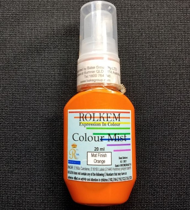 Orange Matte Color Mist 20 ML by Rolkem is a food approved, non-toxic, edible paint color. This paint product can be sprayed directly onto sugar paste, fondant, icing, and even chocolate items. This paint product can also be mixed into sugar paste, pastillage, fondant, royal icing, butter icing, cocoa butter, and ethanol.