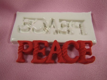 "The word PEACE, By Jennifer Dontz, measures 3/4"" x 3"". The mold can be used with isomalt, chocolate, fondant, gumpaste, ect."