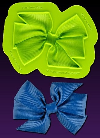 "Pinwheel Bow Mold, by Elisa Strauss and Marvelous Molds, measures 2 7/8"" x 2 1/8"" and includes Marvelous Molds' patent pending self ""trimming blade."" This mold is part of the Elisa Strauss Fashion Molds Collection."