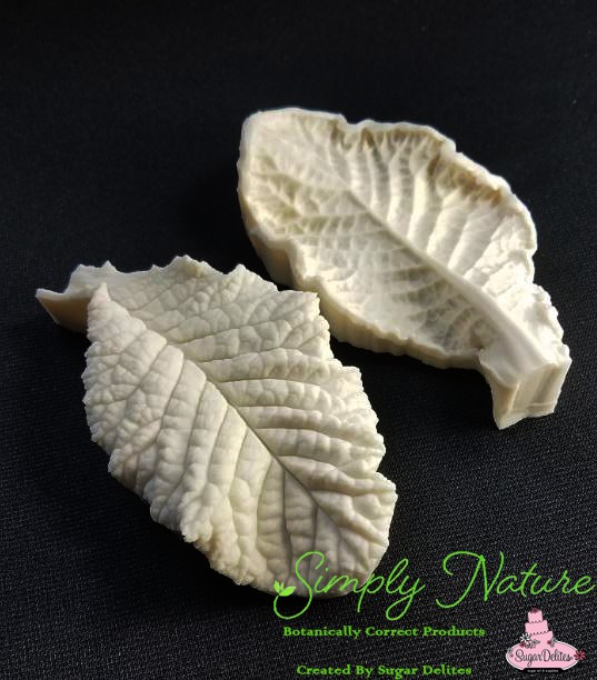 "Primrose Leaf Veiner XL by Simply Nature Botanically Correct Products®, was created by Jason Dontz and Jennifer Dontz of Sugar Delites, and creates the most realistic Primrose Leaf interpretation possible. The XL Primrose leaf veiner measures 5"" x 2 3/4"". Simply Nature brand veiners capture each ruffle, pillow & vein because they were created from the actual top and the actual bottom of each leaf or petal, thus creating the most realistic replica of nature. Botanically correct veiners leave room for your wire and will not cut your paste and since the veiners were created by nature, they also shape and form your medium as well. Each Simply Nature Brand veiner is made in the USA and is poured using the highest quality platinum based, food approved silicone. The matching cutter(s) for this veiner(s) is CUT723."