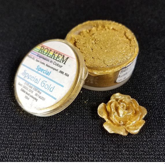 """Special"" Gold Metallic Dust by Rolkem 10ML. This metallic highlighter dust is food approved in Europe, Canada, and Australia, otherwise it is considered non-toxic and for decorative use only. Rolkem super dust colors provide a glossy finish and will give your finished piece a beautiful metallic look. You can paint, mix, or dry brush this dust on fondant, gumpaste, icing, etc. and it leaves a brilliant shine. Color can slightly vary from batch to batch."