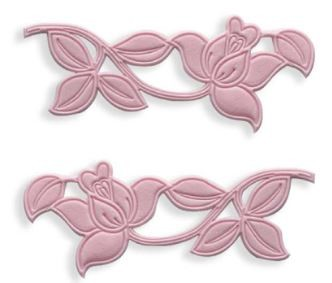 "Rose Cutwork Set, by JEM, each measure approximately 4"" x 1 1/2""."