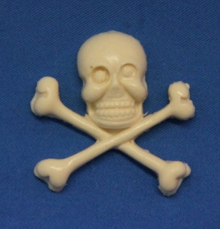"Skull & Cross Bones, by DTC, measures 1 3/8"" x 1 1/4"" x 1/4""."