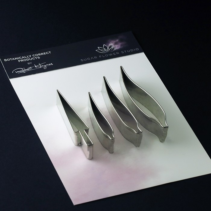 "Bird Of Paradise petal & stamen rolled edge metal cutter small set of 4 measurements – small petal length 6.4 cm x width 1 cm, medium petal length 8 cm x width 1 cm, large petal length 9 cm x width 1.9 cm, stamen length 7.7 cm x width 1.2 cm. (small petal length 2 1/2"" x width 3.8"", medium petal length 3 1/8"" x width 3/8"", large petal length 3 1/2"" x width 3/4"", stamen length 3"" x width 1/2"").This distinctive range of Botanically Correct Products By Sugar Flower Studio are designed by master sugar artist Robert Haynes. These quality products can be used to replicate time and again, stunning life like flora in any edible or non-edible medium of your choice. The rolled edge cutters in the Sugar Flower Studio range are perfectly matched to fit within the perimeters of each corresponding silicone veiner, giving you a time efficient and botanically correct result each time. These cutters can be used with edible mediums including sugar flower paste (SFP) gum paste, fondant, modelling chocolate and marzipan. They can also be used with non-edible modelling mediums: cold porcelain (Modena), Hearty - Artista soft, polymer clay and modelling clay. Instructions for use of products: Using the Sugar Flower Studio Hand saver, place on top of each cutter, cut out petals or leaves. Place thinned out petal or leaf shape into lightly corn-floured Sugar Flower Studio veiner. Press firmly to give a natural vein. Remove petal or leaf and allow medium to go leathery before colouring. To clean cutters, wipe with an alcohol dampened soft cloth after each use. Copyright © 2016 Sugar Flower Studio."
