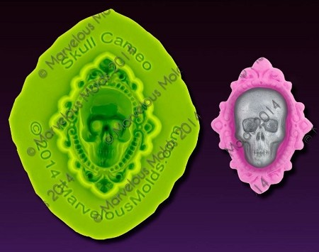 "Skull Cameo Mold, by Elisa Strauss and Marvelous Molds, measures 1 1/8"" x 1 3/8"" and includes Marvelous Molds' patent pending self ""trimming blade."""