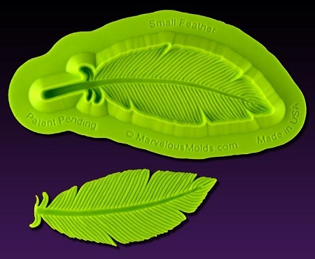 "Small Feather Mold, by Elisa Strauss and Marvelous Molds, measures 2 3/8"" x 15/16"" and includes Marvelous Molds' patent pending self ""trimming blade."" This mold is part of the Elisa Strauss Fashion Molds Collection."