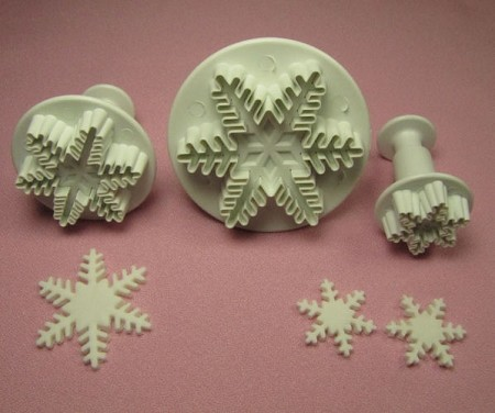"Snowflake Plungers by PME, Set of 3. The plungers measure 2"",  1 1/2"", and 1"" in diameter. Instructions included."